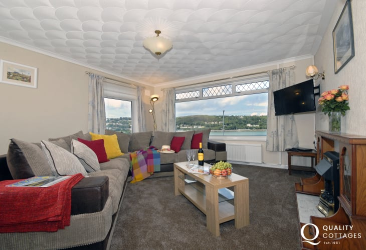 Comfortable living room room with electric fire and harbour views