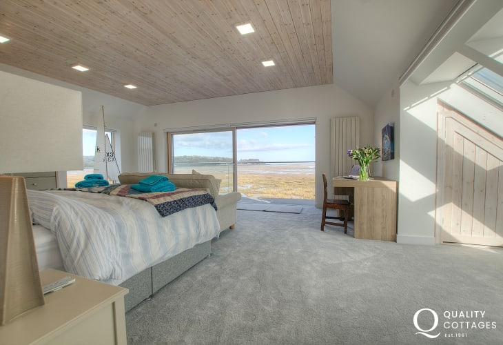 Luxury holiday cottage - Main bedroom with king size bed, ensuite wet room and balcony overlooking Red Wharf Bay in Anglesey.