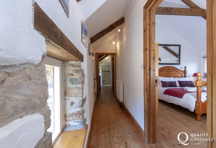 St Davids holiday home - narrow landing area leading to 3 bedrooms and family shower room