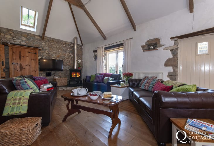 Newgale 18th century Welsh barn conversion - spacious sitting room with multi-fuel burning stove