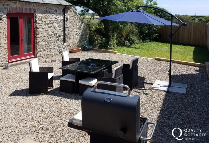 Rattan patio set table and eight chairs, bbq with parasol