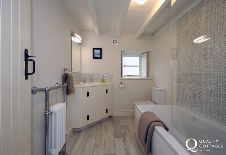 St Davids holiday home - family bathroom with shower over bath