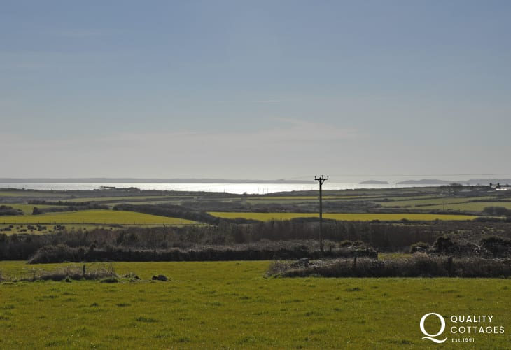 Enjoy fabulous views across farm and moorland to St Davids and St Brides Bay  beyond