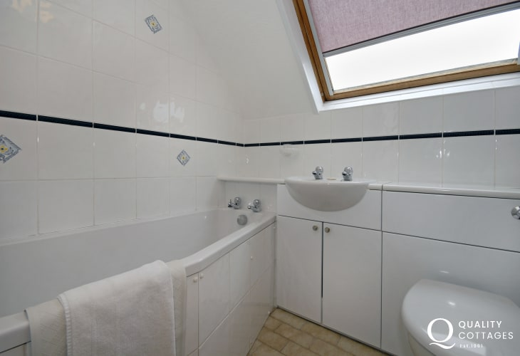 St Davids holiday apartment - bathroom with shower over bath