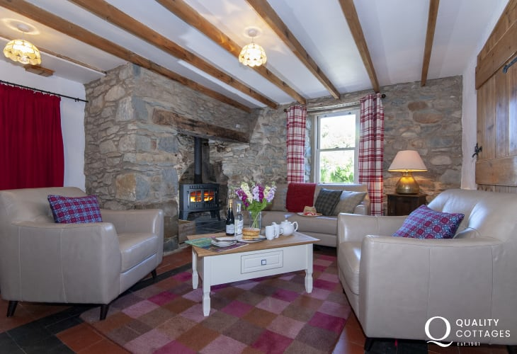 Newgale traditional 18th century Welsh farmhouse - cosy sitting room with large inglenook and multi-fuel stove