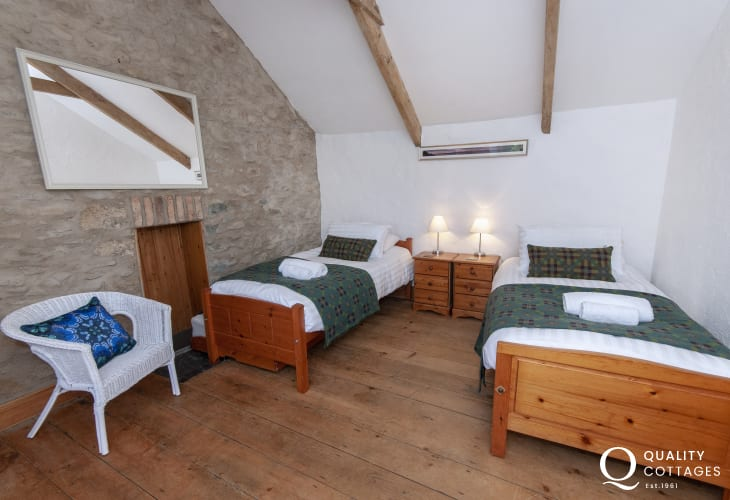 Solva traditional farmhouse sleeps 9 - twin with countryside views bedroom