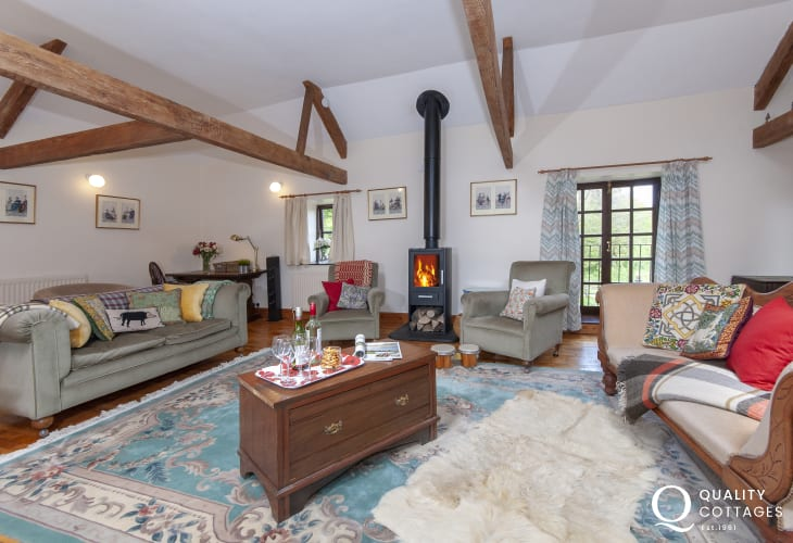 Rhossili family holiday barn -  sitting room with vaulted ceiling and wood burning stove