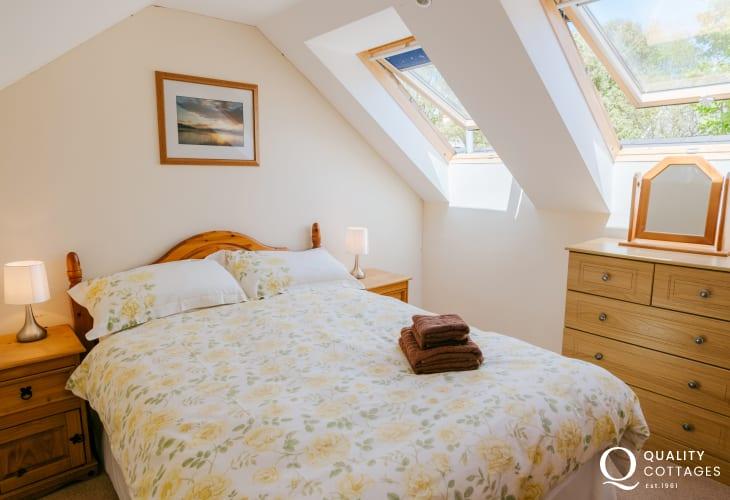Bedroom with double bed dormer windows
