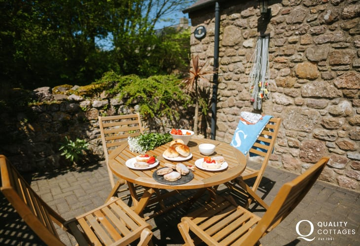 Garden table and chairs welsh cakes and cream strawberries