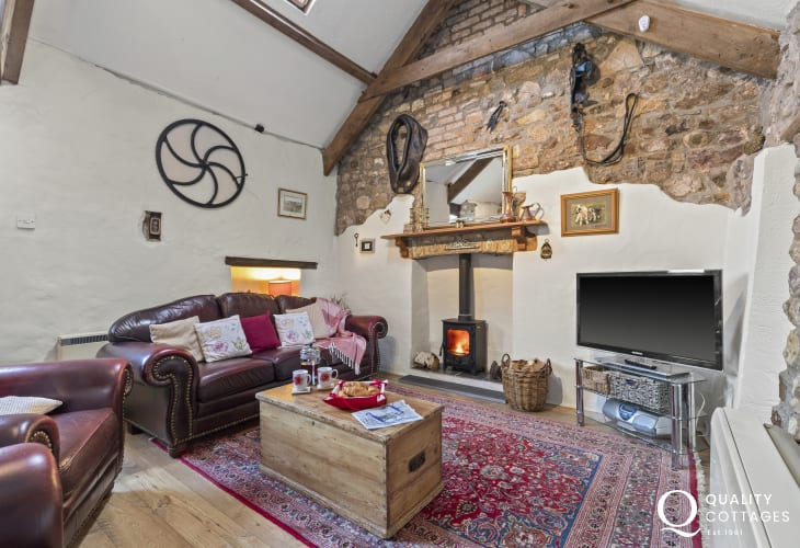 Leather sofa and two chairs and log burner TV