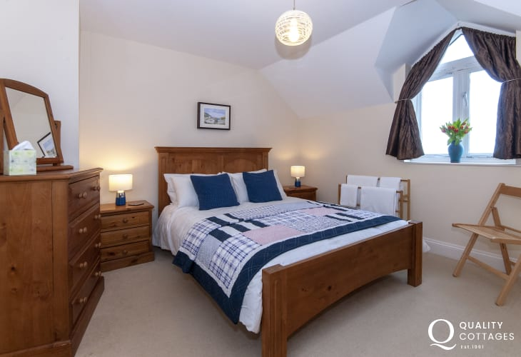 Pembrokeshire cottage sleeps 8 - double bedroom with coastal views