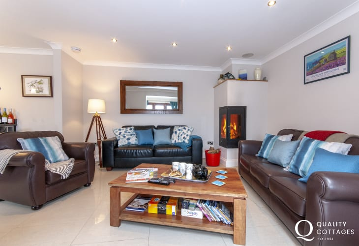 North Pembrokeshire holiday cottage - open plan living room with log burning stove