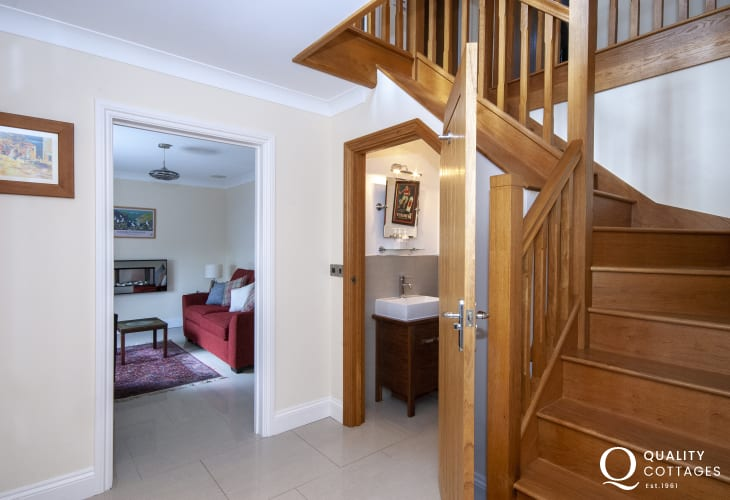 Trefin holiday home - entrance hall with smart cloakroom under the stairs