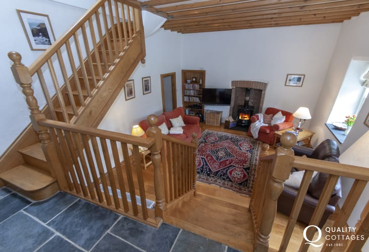 Mathry holiday cottage - open plan sitting room with log burning stove