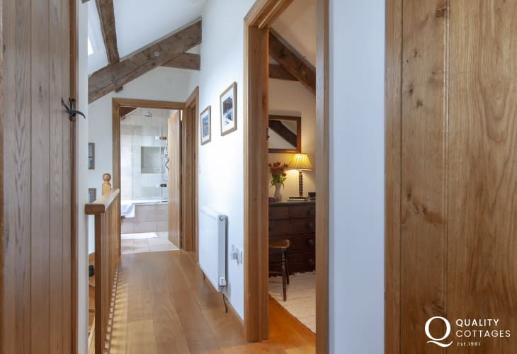Mathry restored stone cottage with Oak floors and A-frame beams - landing
