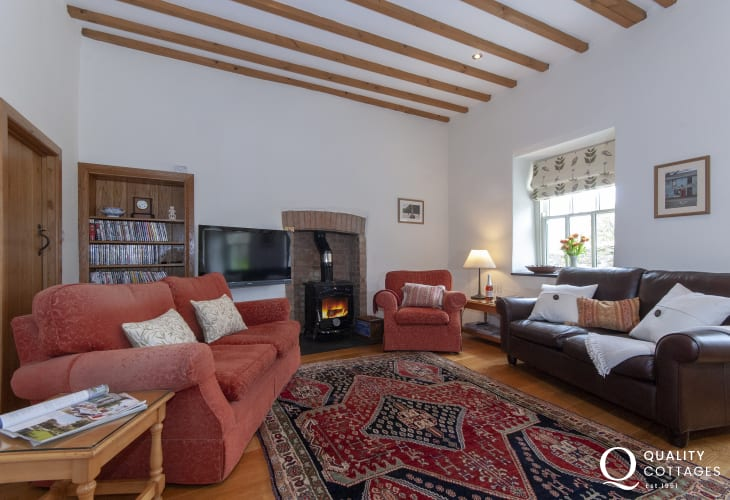 Abercastle luxury holiday cottage open plan sitting room with log burning stove