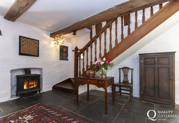 Creswell Quay holiday home- entrance hall with flagstone floor and log burning stove