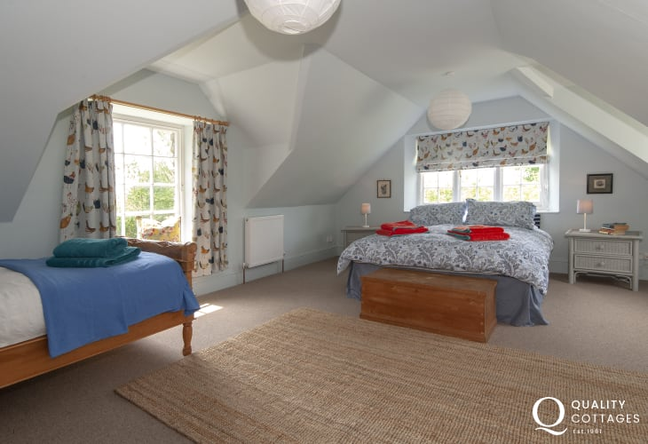 Cresswell Quay holiday house sleeps 9 - family bedroom with king size and single bed