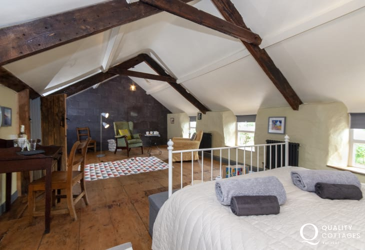 North Pembrokeshire holiday cottage - spacious double bedroom with sitting area with comfortable chairs