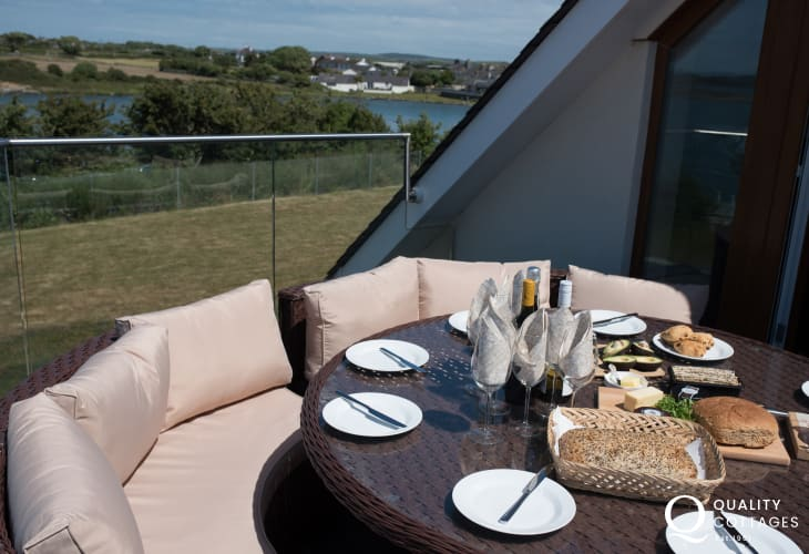 Dog friendly holiday cottage in Anglesey- balcony with panoramic sea views and seating. Sleeps nine.