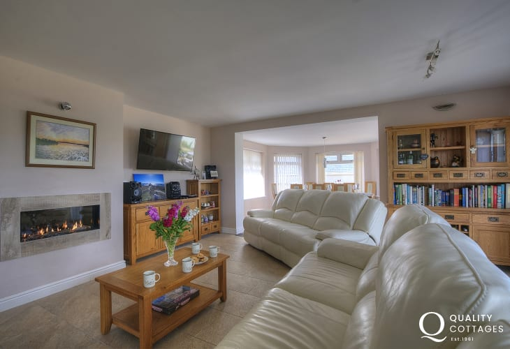Four Mile Bridge holiday cottage - spacious modern lounge with gas fire, leather sofas and smart TV in Anglesey.