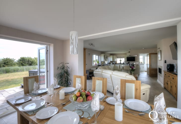 Five bedroom holiday cottage with hot tub in coastal Anglesey - open plan dining area with doors that open onto patio.