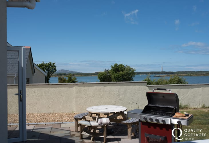 Anglesey, North Wales luxury holiday cottage - garden with sea view, outdoor seating and barbecue.