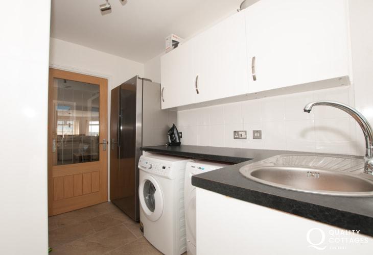 Anglesey holiday house in Four Mile Bridge - utility room with washing machine and tumble dryer, larder fridge/freezer.