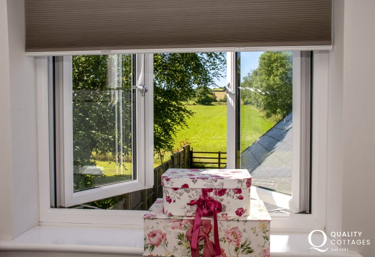 Views over the surrounding meadows from the master bedroom