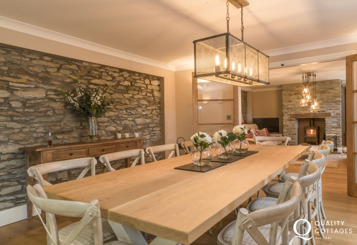 Dining room large table feature exposed stone wall