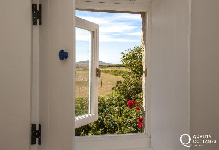 Views to Ramsey Island through the shuttered bathroom window