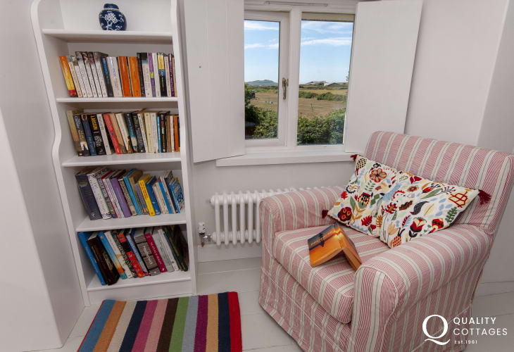 St Davids restored holiday cottage - master bedroom with coastal views
