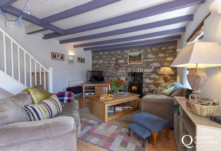 Trefin, Pembrokeshire traditional cosy holiday cottage - living room with wi-fi and wood burner