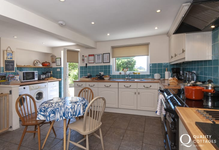 Self-catering Pembrokeshire coastal cottage - luxury spacious kitchen with doors to the rear enclosed gardens