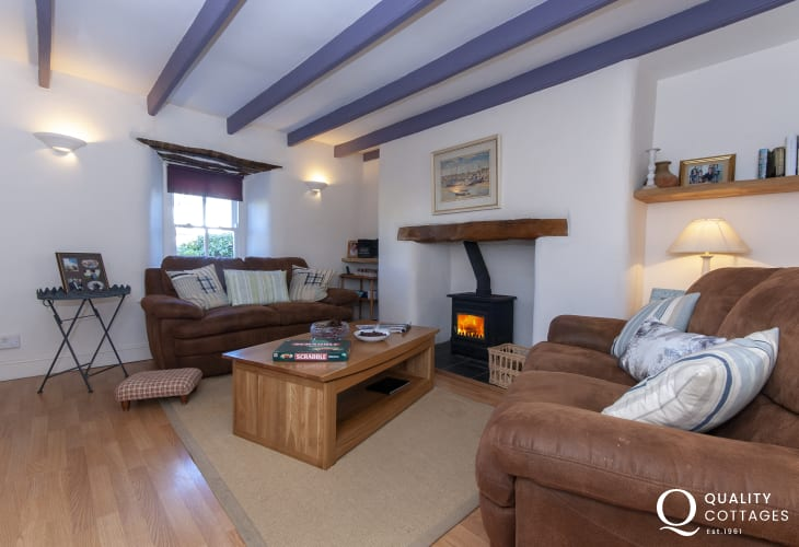 Trefin family holiday cottage - open plan snug/diner with wood burner