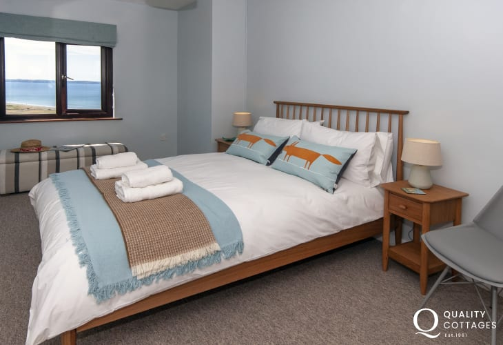 Newgale holiday cottage sleeping 6 - double bedroom with sea views over Newgale Sands