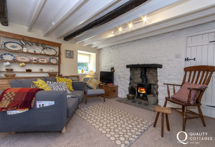 North Pembrokeshire traditional Welsh stone coastal cottage - cosy living room with wood burner