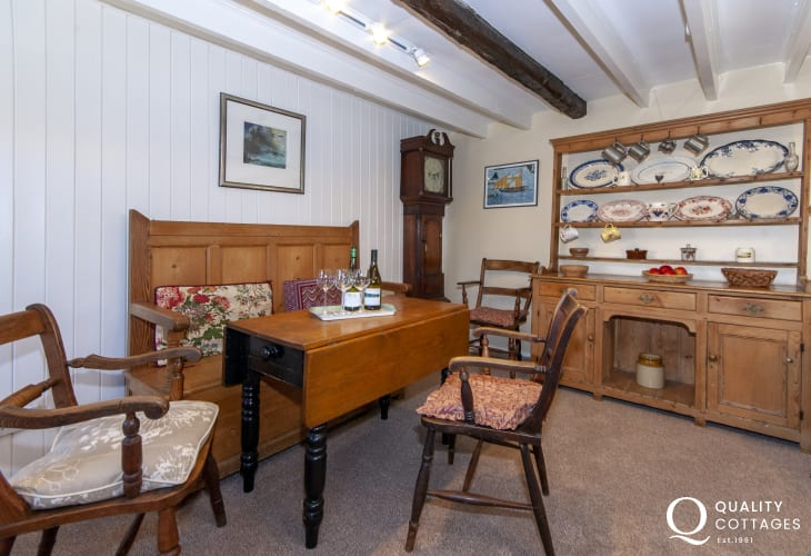 Porthgain holiday cottage - living room with antique Settle, Welsh Dresser and Grandfather clock