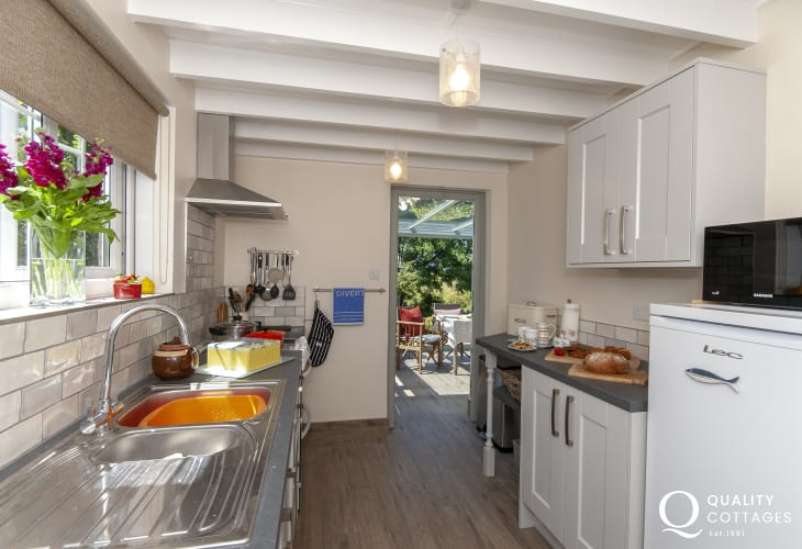 Self catering North Pembrokeshire - modern kitchen leading to the conservatory/diner