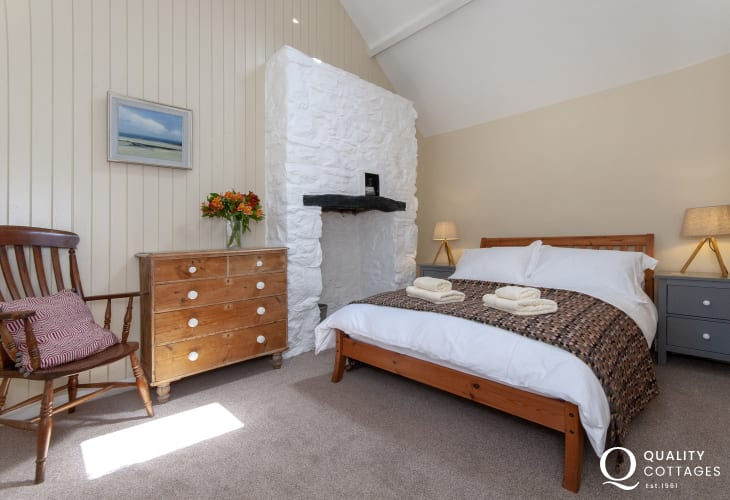 Porthgain holiday cottage sleeping 4 - king size bedroom with feature inglenook fire place