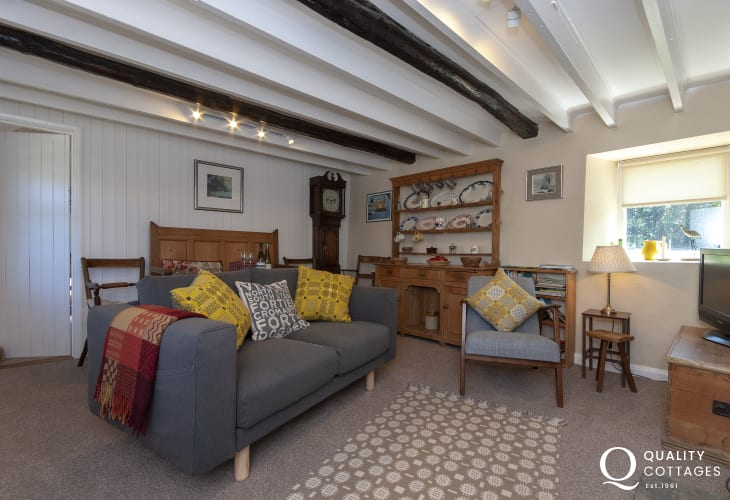 Porthgain cosy holiday cottage - living room with Welsh Dresser and Grandfather clock