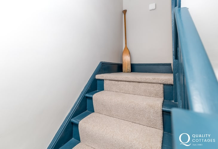 Stairs / hallway in holiday cottage with sea views on the Dale Peninsula, Pembrokeshire.