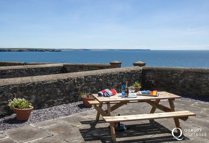 Pet friendly Dale holiday cottage - terrace overlooking the sea