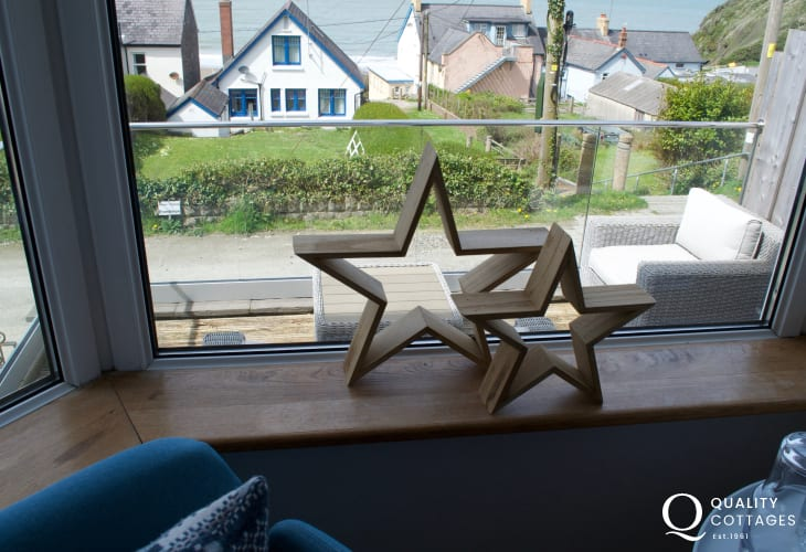Stars in lounge window sea views