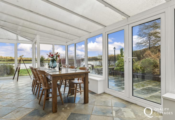 Conservatory extension with views of the tidal Cleddau River - dining room