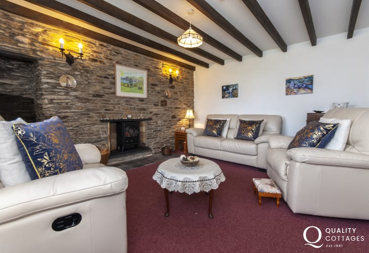 Porthgain, Pembrokeshire holiday cottage - sitting room with electric effect log burner