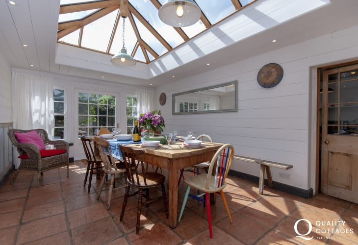 Carew holiday cottage - conservatory/dining room with Lantern glass roof and doors to the garden