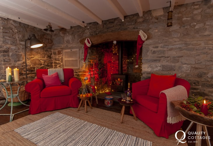 South Pembrokeshire holiday cottage - spacious sitting room with large Inglenook fireplace and log burner