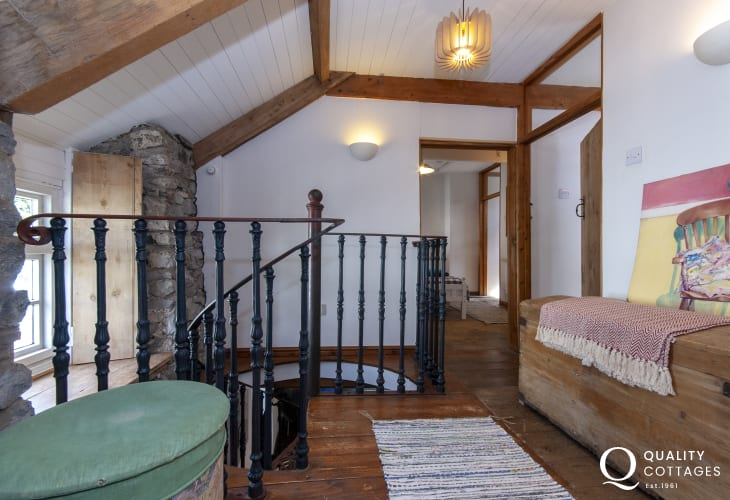 Traditional Welsh cottage with stone walls and spiral staircase - landing