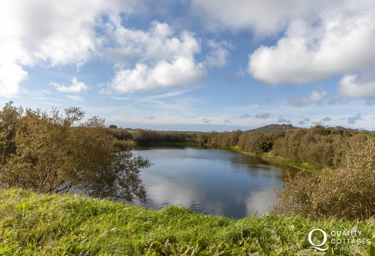 Guests can enjoy some quiet time fishing down by the lake at 'Caersegan'